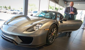 Tim Bamford, sales specialist at Porsche of London, shows off the $1.4 million Porsche 918 Spyder.  Bamford, a St. Thomas native, spent over a year brokering the deal on the custom car which was manufactured by hand in Germany and purchased by an unnamed client in the region.