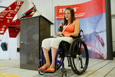 Ste. Anne's resident Maranda Lanouette, who is now a STARS Very Important Patient (VIP), speaks about her experience with a STARS air ambulance crew after she was injured in an ATV accident. Lanouette was a guest speaker at the STARS open house held at the hangar in Winnipeg, Man., on Sat., May 23, 2015. (Brook Jones/Postmedia Network)