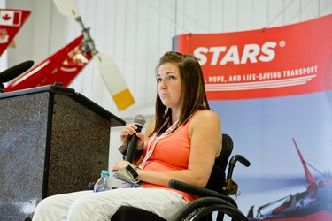 Maranda Lanouette, who is now a STARS Very Important Patient (VIP), speaks about her experience with a STARS air ambulance after she was injured in an ATV accident. Lanouette was a guest speaker at an open house held at the STARS base in Winnipeg, Man., on Sat., May 23, 2015. (Brook Jones/Postmedia Network)