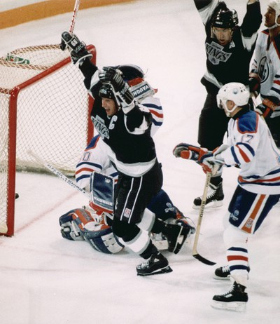 Oct . 15,1989. LA Kings captain and ex-Edmonton Oilers Wayne Gretzky celebrates scoring his 1851st point against Edmonton Oilers Bill Ranford on Oct 15, 1989. The 1851 points broke hockey legend Gordie Howe's NHL record of 1,850. In typical Gretzky fashion he scored the record setting point with only 53 seconds left in the third period, he then scored the goal to win the game in overtime against his old team. Also in the photo are Oilers Juri Kurri, Kevin Lowe and Kings Dave Taylor. Edmonton Sun/QMI Agency