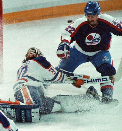 April 6, 1990. Edmonton Oiler goalie Bill Ranford makes a point blank toe save off of Winnipeg Jets Moe Mantha during game two of the Smythe Division Semi-Finals at Northlands Coliseum in Edmonton, Alta., on April 6, 1990. The Oilers went on to win the series in seven games. The Oilers would go on to beat the Boston Bruins in five games to win their fifth cup. Tom Braid/Edmonton Sun/QMI Agency