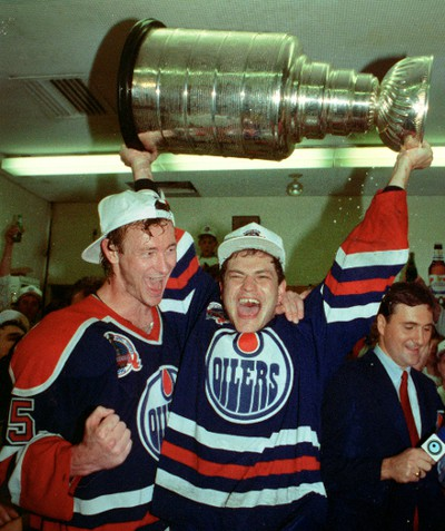 May 24, 1990. Edmonton Oilers defenceman Steve Smith (left) and forward Esa Tikkanen celebrate in the dressing room after the Oilers won their fifth Stanley Cup championship after beating the Boston Bruins in five games on May 24, 1990. Tom Braid/Edmonton Sun/Postmedia Network