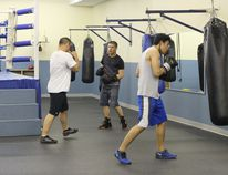 Members at the Derrick Boxing Club practice at the Omniplex during the evening hours.