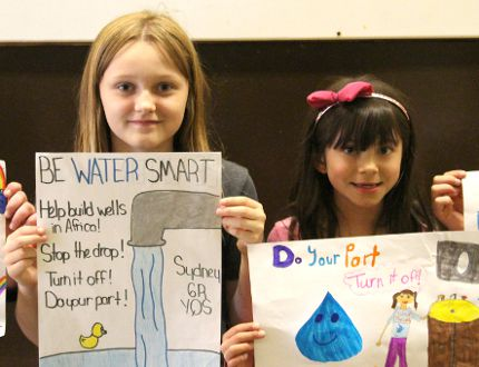 Brianna Kliver, Sydney Miller, Ieisha Harder and Jovie Plett were Yellowquill School's winners of their water poster contest on May 15. The contest coincided with their Water Week from May 11-15, 2015. The winners each received a $3 coupon to the canteen. (Johnna Ruocco/THE GRAPHIC/POSTMEDIA NETWORK)