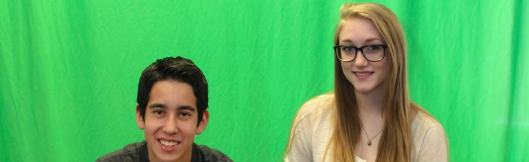 Jillianne Kell, 17, and Cameron Swainson, 16, stand in front of the green screen at Bert Church High School with their slider rig and camera on May 20. The pair won first place at the Skills Canada provincials in Edmonton on May 13-14 and are off to nationals in Saskatoon on May 27-30.
