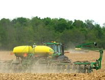Luke Gysbers, foreground, and Dave Cleve, in the other tractor, plant soybeans in a 150-acre field north of London. Although they planned to replant corn, the large amount of corn stalks that survived the winter made it too difficult, so beans were planted instead. (MIKE HENSEN, The London Free Press)