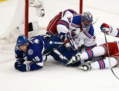 Tampa Bay Lightning left winger Ondrej Palat collides with New York Rangers goalie Henrik Lundqvist and defenceman Keith Yandle collide during Game 4 of the Eastern Conference on March 22, 2015. (Reinhold Matay/USA TODAY Sports)