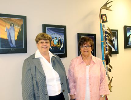 Timmins lawyer Suzanne Desrosiers, and the executive director of the Timmins Native Friendship Centre, Veronica Nicholson stand next to the centre's eagle staff. Desrosiers is one of two attorneys taking the federal Ministry of Aboriginal Affairs to court after the government refused to check RCMP and Ministry of Health records for evidence of alleged criminal charges being laid against former staff members of the Bishop Horden Indian Residential School in Moose Factory.