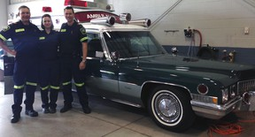 Elgin-St. Thomas paramedics Joe Hill, left, Sareen Tucker and Aaron Smith in front of a 1971 Cadillac ambulance at the Medavie EMS Elgin St. Thomas open house Monday. Visitors were able to take a look at modern paramedic equipment as well as two historic vehicles.
