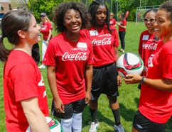 Canadian women's soccer team members Diana Matheson (left) and Desiree Scott (right) share tips with Special Olympic athletes at U of T yesterday. (Dave Thomas/Toronto Sun)