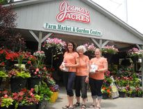 Andrea Otten, Marge De Blieck and Amelia De Blieck serve customers looking for plants and produce at Josmar Acres Farm Market & Garden Centre. Michael-Allan Marion/Brantford Expositor/Postmedia Network