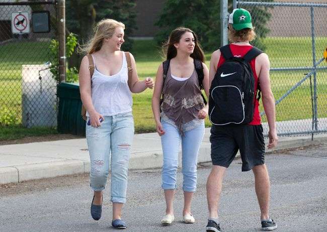 Hundreds of A.B. Lucas Secondary School students defied the school's dress code by wearing sleeveless shirts in London, Ont. on Wednesday May 27, 2015. Laura Anderson organized the protest after being sent home by a vice-principal for wearing a halter top on Monday.Derek Ruttan/The London Free Press/Postmedia Network