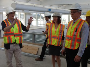Premier Greg Selinger (right), Health Minister Sharon Blady (centre) and Cheryl Susinksi of the Rehabilitation Centre for Children tour the Notre Dame facility that will house the province's Specialized Services for Children and Youth on May 27, 2015.
