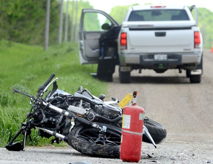 A two-vehicle collision claimed the life of a young motorcyclist at the intersection of Perth Road 110 and Line 40 Wednesday May 27, 2015 northeast of Stratford, Ont. Scott Wishart/Stratford Beacon Herald/Postmedia Network