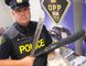 Norfolk OPP Const. Ed Sanchuk holds some of the items seized in a drug bust on Windham Road 12 Wednesday morning (May 27, 2015).  DANIEL R. PEARCE/SIMCOE REFORMER