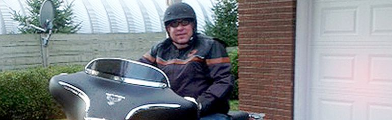 John Potvin sits on his motorcycle in this photo provided by family members. (SUBMITTED PHOTO)