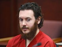 James Holmes sits in court for an advisement hearing at the Arapahoe County Justice Center in Centennial, Colorado in this June 4, 2013 file photo. Prosecutors introduced Holmes' journal on Wednesday, which showed his plans and sketches to shoot civilians in a Colorado movie theatre. Holmes could face the death penalty if convicted of murdering 12 people and wounding 70 others by opening fire inside a suburban Denver multiplex in July 2012. REUTERS/Andy Cross/Pool/Files