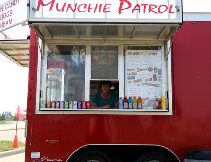 Joanna Persson and her food truck Munchie Patrol is one of the city's newest food vendors. Persson and her truck will be seen throughout the city this summer and sells some of your favourite munchies such as cotton candy, popcorn, pop, chips, hot dogs and smokies. Jocelyn Turner/Daily Herald-Tribune/Postmedia Network