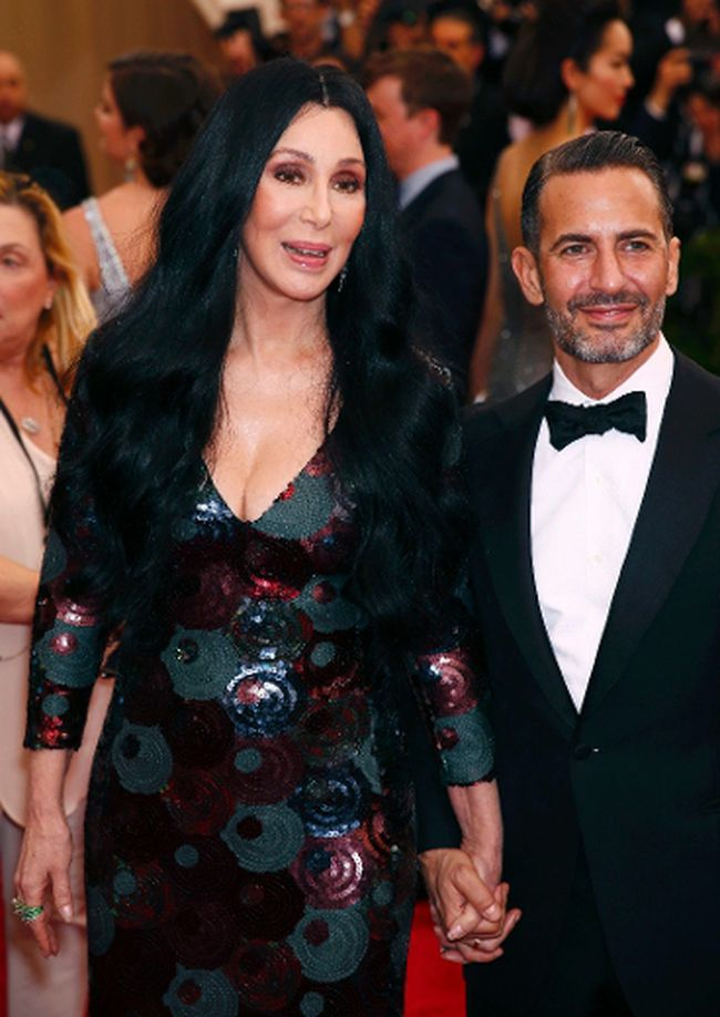 "Cher and designer Marc Jacobs arrive at the Metropolitan Museum of Art Costume Institute Gala 2015 celebrating the opening of ""China: Through the Looking Glass,"" in Manhattan, New York May 4, 2015.  REUTERS/Lucas Jackson"