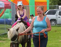 Claire Wendt, 4, gets a pony ride at the Ricklyn Farm petting zoo at Jumpstart Day on May 31, 2014 at Canadian Tire. (Johnna Ruocco/THE GRAPHIC/QMI AGENCY)