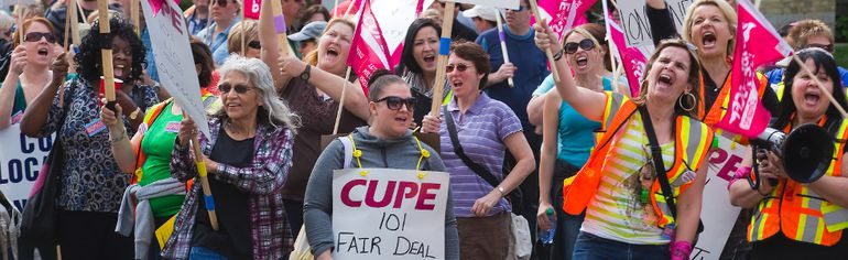 Some of London's 750 inside city workers rally outside of city hall on the first day of their strike in London on Monday. Derek Ruttan/The London Free Press/Postmedia Network
