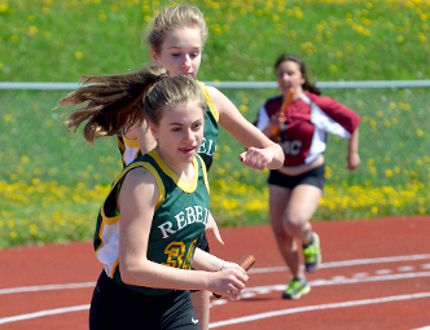 Zoey MacCoy sprints off on the final leg of one of the 4x100-metre relay heats after being handed the baton by her Roland Michener Secondary School teammate Emma Boucher during the Justin Lambert-Bélanger Relays at the Timmins Regional Athletics and Soccer Complex Thursday. The Rebels relay team posted the fastest time in the Grade 7 & 8 Division, finishing the event in a time of 59.00 seconds.