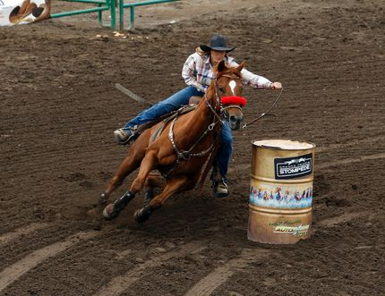 Okotoks, Alta. native Deb Guelly makes her final turn on Thursday May 28, 2015 during the ladies barrel racing event, part of the Thursday slack draw at the Grande Prairie Stompede at Evergreen Park in Grande Prairie, Alta. Tom Bateman/Grande Prairie Daily Herald-Tribune/Postmedia Network