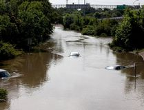 Flood waters cover several cars on the South I-610 frontage road in Houston, Texas on May 26, 2015. (REUTERS/Daniel Kramer)