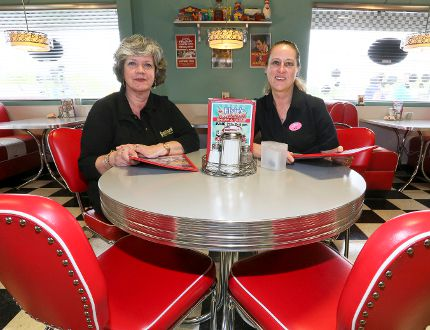 Jane Phillips, manager of the Business Enterprise Centre in Owen Sound, and Chris Heathers, owner of Elsie's Diner, at the restaurant in Springmount. Elsie's Diner opened after Heathers enrolled in the OSEB program, which the province plans to scrap in March. JAMES MASTERS/THE SUN TIMES