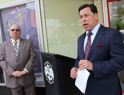 Brad Duguid, Minister of Economic Development, Employment and Infrastructure, announces plans for a new provincial accessibility certification program outside Sarnia's Imperial Theatre Friday. Pictured with him is Sarnia-Lambton MPP Bob Bailey. Duguid was also in Sarnia for the city's second annual Accessibility Summit, and was meeting with local manufacturing sector representatives. Tyler Kula/Sarnia Observer/Postmedia Network