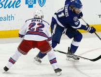 Lightning centre Steven Stamkos (right) carries the puck past Rangers defenceman Dan Boyle (22) during Game 4 action in the Eastern Conference final in Tampa, Fla. The series will be decided tonight in New York in Game 7. (Reinhold Matay/USA TODAY Sports)
