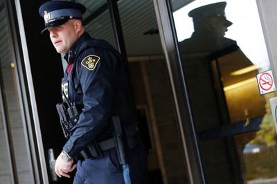 OPP Const. Ryan Besner leaves with Ottawa Courthouse Tuesday November 5, 2013. Besner is the investigating officer in the drunk driving case for Dr. Christy Natsis. OTTAWA SUN FILES