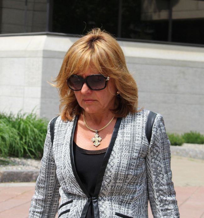 Pembroke dentist Dr. Christy Natsis leaves the Elgin Street courthouse in Ottawa through a side door Friday, May 29, 2015 after she was convicted of impaired and dangerous driving, both causing death, in the March 2011 crash that killed Bryan Casey.