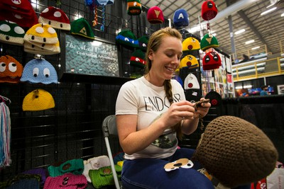 Crystal Ionson crochets at her booth, The Mad Hatter's Crocheting Adventures, during Eek! Fest 2015 at Servus Place in St. Albert in Edmonton, Alta., on Sunday, May 31, 2015. The two-day pop culture festival attracts thousands of comic, art, film and video game fans. Ian Kucerak/Edmonton Sun/Postmedia Network