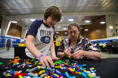 Elvis Anderson, 9, plays with Lego bricks with his mother Jennifer in the Bricks Studio area at Eek! Fest 2015 at Servus Place in St. Albert in Edmonton, Alta., on Sunday, May 31, 2015. The two-day pop culture festival attracts thousands of comic, art, film and video game fans. Ian Kucerak/Edmonton Sun/Postmedia Network
