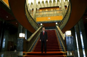 Turkey's President Tayyip Erdogan poses after an official ceremony to mark Republic Day at the new Presidential Palace in Ankara, Turkey, in this October 29, 2014 file photo. Erdogan says he will resign if opposition leader Kemal Kilicdaroglu can find a golden toilet seat in his new palace. REUTERS/Umit Bektas/Files