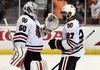 Chicago Blackhawks goalie Corey Crawford (50) and defenceman Johnny Oduya (27) celebrate the 5-3 victory against the Anaheim Ducks following game seven of the Western Conference Final of the 2015 Stanley Cup Playoffs at Honda Center May 30, 2015. (Gary A. Vasquez-USA TODAY Sports)