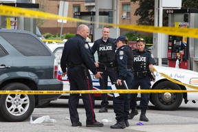 Scene at Lawrence Ave. and Bellamy Rd. where a man was found dead in a vehicle after being shot at Lawrence Ave. and Greencrest Circuit in Toronto on Monday June 1, 2015. (Craig Robertson/Toronto Sun)