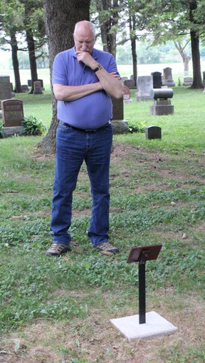 Thomas Wylie looks at the grave of James Barr Glen. Wylie is from Scotland and only knew that his great uncle had died on Lake Huron last year when he contacted Kathy Pletsch of the Great Lakes Storm of 1913 committee. (Laura Broadley Clinton News Record)