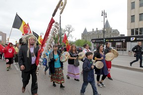 A group of people marched from the University of Winnipeg to Thunderbird House in Winnipeg, after hearing the findings of the Truth and Reconciliation Commission's findings.