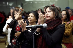 Attendees applaud at a Truth and Reconciliation Commission of Canada event in Ottawa June 2, 2015. The Truth and Reconciliation Commission of Canada presented its final report on the Indian Residential Schools.    REUTERS/Blair Gable