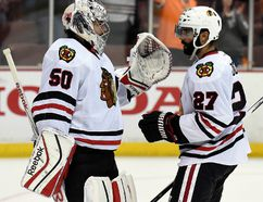 Chicago Blackhawks goalie Corey Crawford and defenceman Johnny Oduya celebrate the 5-3 victory against the Anaheim Ducks following Game 7 of the Western Conference Final of the 2015 NHL playoffs at Honda Center on May 30, 2015. (Gary A. Vasquez/USA TODAY Sports)