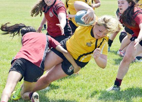 Trenton High Tigers' Abby Refausse dives over the try line on the final play of the game to give the Tigers a dramatic 20-17 semi-final win over Rockcliffe's Ashbury College Tuesday at the OFSAA 'AA' girls rugby championships at the Brampton Rugby Club. The Tigers hammered the Barrie Central Phoenix 32-0 in Wednesday's gold medal match to successfully defend their provincial crown. Catherine Frost/For The Intelligencer