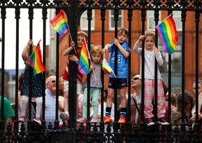 Children wave rainbow flags as they stand with their same-sex marriage supporting parents at Dublin Castle May 23, 2015.