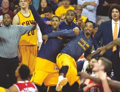 Cavaliers' (left to right) Tristan Thompson, LeBron James and J.R. Smith celebrate on the bench, (USA TODAY SPORTS)