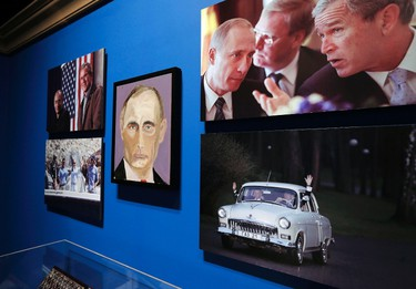 """A portrait of Russian President Vladimir Putin, painted by former U.S. President George W. Bush, is displayed at """"The Art of Leadership: A President's Personal Diplomacy"""" exhibit at the Bush Presidential Library and Museum in Dallas, Texas April 4, 2014. Former U.S. President George W. Bush on Friday revealed a series of portraits of world leaders he painted in a new pursuit. The exhibit opens Saturday and will feature Bush's paintings of some two dozen world figures he worked with during his 2001-2009 presidency. REUTERS/Brandon Wade"""
