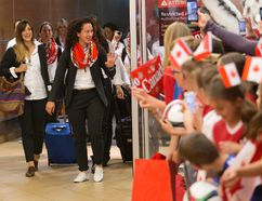 Canada's Women's World Cup team arrives to a large group of fans at the Edmonton International Airport on Tuesday, June 2, 2015. (David Bloom/Postmedia Network)
