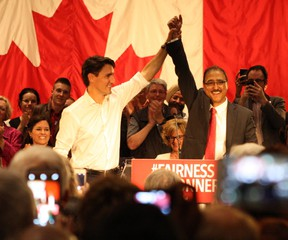 Amarjeet Sohi and Liberal Party leader Justin Trudeau raise each others' hands in front of a packed house at the Maharaja Hall in Edmonton on June 4, 2015 at his campaign launch. Sohi, a former city councillor, is running as a Liberal Party candidate for Mill Woods in the upcoming federal election.