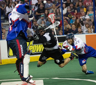The Edmonton Rush's Zack Greer (88) makes a diving shot against the Toronto Rock's Brandon Miller (35) and Bill Greer (21) during second half NLL Champions Cup Finals action at Rexall Place, in Edmonton Alta. on Friday June 5, 2015. David Bloom/Edmonton Sun/Postmedia Network