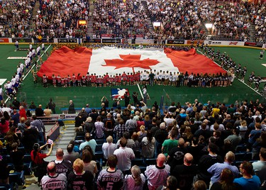 Lacross fans sign O Canada prior to the start of the Edmonton Rush and Toronto Rock Champions Cup game at Rexall Place, in Edmonton Alta. on Friday June 5, 2015. David Bloom/Edmonton Sun/Postmedia Network